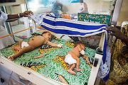 Two babies about to start photo therapy on the machine supplied by VSO in the NICU (Neonatal Intensive Care Unit) Ward. St Walburg's Hospital, Nyangao. Lindi Region, Tanzania.