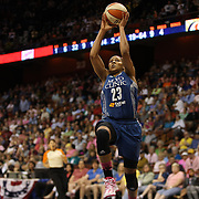 Maya Moore, Minnesota Lynx, drives to the basket during the Connecticut Sun Vs Minnesota Lynx, WNBA regular season game at Mohegan Sun Arena, Uncasville, Connecticut, USA. 27th July 2014. Photo Tim Clayton