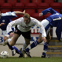 St Johnstone v Clyde..27.11.04<br />Aaron Wilford is brought down by Jordan Tait and Lee Hardy<br /><br />Picture by Graeme Hart.<br />Copyright Perthshire Picture Agency<br />Tel: 01738 623350  Mobile: 07990 594431