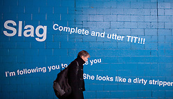 © Licensed to London News Pictures. 21/02/2013. London, UK. EMBARGOED UNTIL FRIDAY 22nd FEBRUARY. A person walks pas an installation created from actual abuse collected from the internet on display at London's IMAX underpass today (21/02/2013). The installation, created by youth charity 'vInspired' as part of their latest 'Do Something UK' action from the 'Lolz not Trolls' campaign, is designed to raise awareness of the kind of abuse faced by young people on the internet, with figures suggesting that a third of 14-18 year olds have been 'trolled' online. Photo credit: Matt Cetti-Roberts/LNP