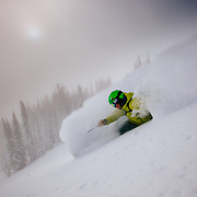 Bryce Newcomb skis blower powder with a clearing storm in-bounds at JHMR.