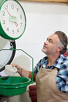Mature man looking up at weight scale