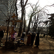 KIEV, UKRAINE - February 24, 2014: People pray at a shrine in a park beside Ukraine's parliament building in Kiev. CREDIT: Paulo Nunes dos Santos