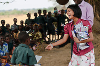 Sasha Kasthuriarachchi handing out pencil cases donated by Chorlton School to children of the Chisila Community School supported by PEPAIDS, St Mary's, Monze, Zambia. PEPAIDS is a UK-based NGO whose mission is to promote and preserve the health of people in Zambia through the provision of support for HIV/AIDS initiatives and the promotion of awareness of issues surrounding HIV/AIDS. PEPAIDS' local partner NGO is SAPEP, based in the Monze and Mazabuka districts of the Southern Province of Zambia. They work together to empower the rural youth of Zambia to mobilise their communities to fight poverty and HIV/AIDS. SAPEP works with a large number of AIDS Action clubs (AACs) who are trained by SAPEP project staff in subjects such as peer education approaches; gender, customs and traditions; antiretroviral therapy; and counselling. This training empowers the AACs to support the communities in which they are based in the fight against HIV and AIDS. SAPEP encourages AACs to start income generating activities with the goal of being self-reliant and self-sufficient in their mission to alleviate HIV and AIDS. PEPAIDS has designed its training programme to form a cascade in order to reach as many people as possible. Peer educators participate in Training of Trainers workshops, with skills being passed on to club leaders and club members in turn to benefit the wider community. The entire programme is designed to be sustainable, youth-focused, participatory and culturally acceptable.