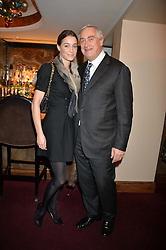 GEORGIE RYLANCE and GIUSEPPE CIARDI at a party hosted by Lady Kinvara Balfour, Lavinia Brennan and Lady Natasha Rufus Isaacs to celebrate the Beulah French Sole Collaboration in aid of the UN Blue Heart Campaign, held at George, 87-88 Mount Street, London on 10th December 2013.