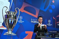NYON, SWITZERLAND - Monday, December 17, 2018: Former Liverpool player and Champions League winner Luis Garcia holds up Real Madrid after making the draw during the UEFA Champions League 2018/19 Round of 16 draw at the UEFA House of European Football. (Handout by UEFA)