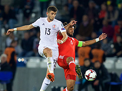 TBILSI, GEORGIA - Friday, October 6, 2017: Wales' captain Ashley Williams and Georgia's Giorgi Kvilitaia during the 2018 FIFA World Cup Qualifying Group D match between Georgia and Wales at the Boris Paichadze Dinamo Arena. (Pic by David Rawcliffe/Propaganda)