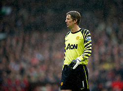 MANCHESTER, ENGLAND - Sunday, September 19, 2010: Manchester United's goalkeeper Edwin van der Sar in the rain during the Premiership match against Liverpool at Old Trafford. (Photo by David Rawcliffe/Propaganda)