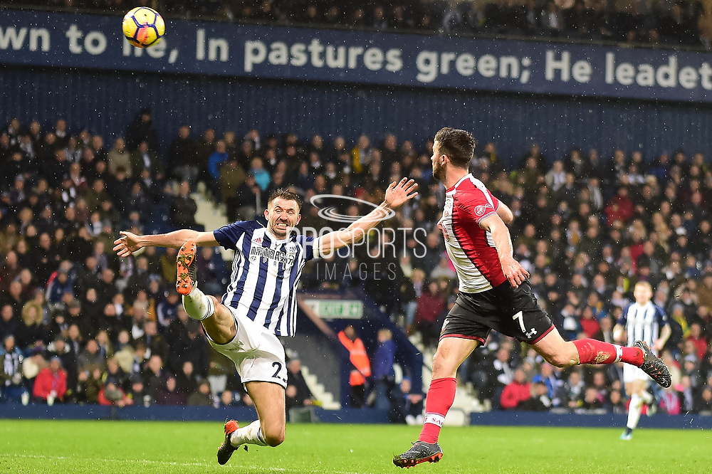 West Bromwich Albion defender Gareth McAuley (23) clears in front of Southampton striker Shane Long (7) during the Premier League match between West Bromwich Albion and Southampton at The Hawthorns, West Bromwich, England on 3 February 2018. Picture by Dennis Goodwin.