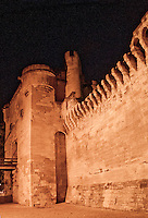 Detail of battlements on the outer city wall of Avignon, France at night.