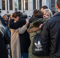 © Licensed to London News Pictures. 02/12/2019. London, UK. People weep and hug each other during the Vigil at the Guildhall London for the victims of the London Bridge attack on Friday 29/11/2019. Photo credit: Alex Lentati/LNP