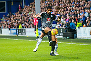 Reading forward Garath McCleary (12) holds off Queens Park Rangers defender Jake Bidwell (3) during the EFL Sky Bet Championship match between Queens Park Rangers and Reading at the Loftus Road Stadium, London, England on 29 December 2018.