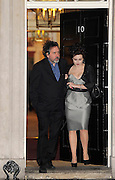 21.FEBRUARY.2011. LONDON<br /> <br /> TIM BURTON AND WIFE HELENA BONHAM-CARTER LEAVING 10 DOWNING STREET AFTER ATTENDING SAMANTHA CAMERON'S DOWNING STREET LONDON FASHION WEEK RECEPTION AND COCKTAIL PARTY.<br /> <br /> BYLINE: EDBIMAGEARCHIVE.COM<br /> <br /> *THIS IMAGE IS STRICTLY FOR UK NEWSPAPERS AND MAGAZINES ONLY*<br /> *FOR WORLD WIDE SALES AND WEB USE PLEASE CONTACT EDBIMAGEARCHIVE - 0208 954 5968*