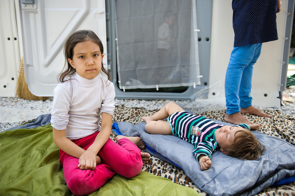 Daniel 1 year and 8 months old from Teheran, Iran sleeps next to Mohadisha 9 years old at Moria camp, Lesvos, Greece.