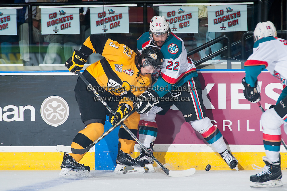 KELOWNA, CANADA - MAY 13: Chance Braid #22 of Kelowna Rockets checks Ivan Provorov #9 of Brandon Wheat Kings during first period on May 13, 2015 during game 4 of the WHL final series at Prospera Place in Kelowna, British Columbia, Canada.  (Photo by Marissa Baecker/Shoot the Breeze)  *** Local Caption *** Chance Braid; Ivan Provorov;