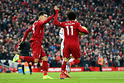 Liverpool striker Mohamed Salah (11) scores a goal 1-1  and celebrates with Liverpool striker Roberto Firmino (9) during the Premier League match between Liverpool and Crystal Palace at Anfield, Liverpool, England on 19 January 2019.