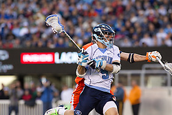 10 April 2010: North Carolina Tar Heels midfielder Jeff Muscatello (9) during a 7-5 loss to the Virginia Cavaliers at the New Meadowlands Stadium in the Meadowlands, NJ.