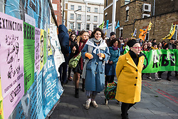 London, UK. 9th February, 2019. Activists from Extinction Rebellion march through Dalston as part of a 'Saturday street party' intended as a means of engagement around climate change and environmental issues with the local community.