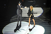 "LAS VEGAS, NV - DECEMBER 08:  Singer/songwriter Tim McGraw (L) and singer Faith Hill perform during the opening weekend of their limited-engagement ""Soul2Soul"" show at The Venetian on December 8, 2012 in Las Vegas, Nevada. The country music couple is scheduled to perform on 10 weekends through April 2013.  (Photo by Jeff Bottari/Getty Images)"