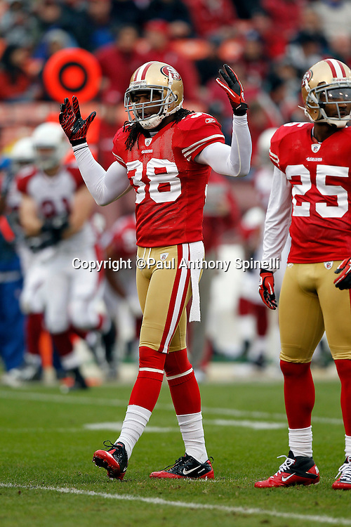 San Francisco 49ers safety Dashon Goldson (38) raises his arms during the NFL week 17 football game against the Arizona Cardinals on Sunday, January 2, 2011 in San Francisco, California. The 49ers won the game 38-7. (©Paul Anthony Spinelli)