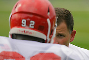 Rutgers football coach Greg Schiano talks to a player during Rutgers football practice.