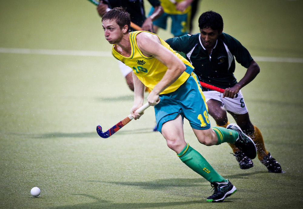 Australia's Kane Posselt and Pakistan's Hafiz Muhammad Umer Sardar in action at the Sultan of Johor Cup match, Johor Bahru, Malaysia, November 11, 2012. Photo: SNPA / Bethelle McFedries