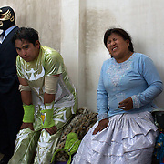 Cholita Carman Rosa feels the pain in the wrestlers dressing room after her fight during the 'Titans of the Ring' wrestling group's Sunday performance at El Alto's Multifunctional Centre. Bolivia. The wrestling group includes the fighting Cholitas, a group of Indigenous Female Lucha Libra wrestlers who fight the men as well as each other for just a few dollars appearance money. El Alto, Bolivia, 24th January 2010. Photo Tim Clayton