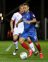 Ricky Miller of Peterborough United is watched by Dean Lewington of Milton Keynes Dons - Mandatory by-line: Joe Dent/JMP - 12/09/2017 - FOOTBALL - ABAX Stadium - Peterborough, England - Peterborough United v Milton Keynes Dons - Sky Bet League One