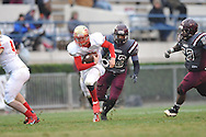 Lafayette High's Devon Thomas (18) runs from Forrest County AHS' Dontavian Lee (32) in the MHSAA Class 4A championship game at Mississippi Veterans Memorial Stadium in Jackson, Miss. on Saturday, December 7, 2013. Forrest County AHS won 21-6.