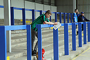 A young Rochdale fan reads the match programme during the EFL Sky Bet League 1 match between Rochdale and Gillingham at Spotland, Rochdale, England on 23 September 2017. Photo by Daniel Youngs.