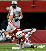 Nebraska Cornhuskers tight end Tyler Hoppes (88) is knocked off his feet during a game on Saturday at Memorial Stadium in Lincoln. (Matt Gade / Republic)