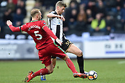 Swansea City defender Mike Van Der Hoorn (5) tackles Notts County forward Jonathan Stead (30) during the FA Cup 4th round match between Notts County and Swansea City at Meadow Lane, Nottingham, England on 27 January 2018. Photo by Jon Hobley.