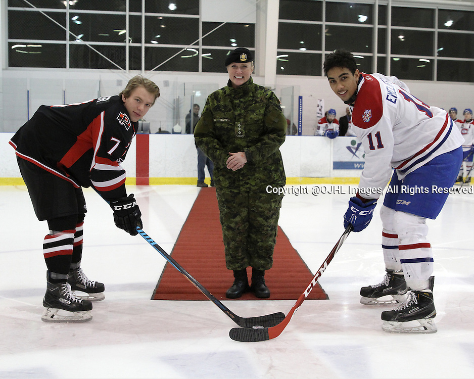 KINGSTON, ON - Dec 3, 2015 : Ontario Junior Hockey League game action between the Pickering Panthers and the Kingston Voyageurs. Doug Carter #7 of the Pickering Panthers &amp; Zachary Emelifeonwu #11 of the Kingston Voyageurs take the ceremonial puck drop from Captain Elisa Holland of the Canadian Armed Forces. <br /> (Photo by Robert John Boucher / OJHL Images)