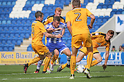 Man of the match and scorer of the first goal Colchester Utd forward Ben Dickenson tries to break through during the EFL Sky Bet League 2 match between Colchester United and Cambridge United at the Weston Homes Community Stadium, Colchester, England on 13 August 2016. Photo by Nigel Cole.