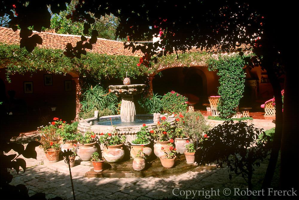 MEXICO, COLONIAL CITIES, GUANAJUATO San Miguel de Allende, colonial fountain and courtyard in historic Villa Santa Monica