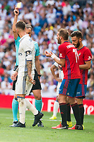 Referee shows yellow card to Real Madrid's player Sergio Ramos and Osasuna's player /Carlos Clerc during a match of La Liga Santander at Santiago Bernabeu Stadium in Madrid. September 10, Spain. 2016. (ALTERPHOTOS/BorjaB.Hojas)