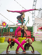 UNITED KINGDOM, London: 10 April 2018. Contortionists from Circus Abyssinia perform in front of the London Eye as they launch their headline run at the Underbelly Festival Southbank. The Ethiopian circus act Circus Abyssinia: Ethiopian Dream's will help celebrate 250 years of circus and 10 years of the Underbelly festival. Rick Findler / Story Picture Agency