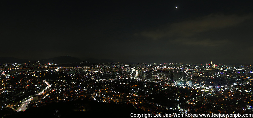 The crescent moon hangs over the skyline of central Seoul August 13, 2013. South Korea has warned of serious power shortages this week amid an expected rise in summer temperatures and as the resources-starved country struggles to keep up with demand after six nuclear plants have gone off-line.  /Lee Jae-Won