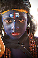 Young girl with face paint dressed up like the Hindu god Shiva for festival, Pushkar, India