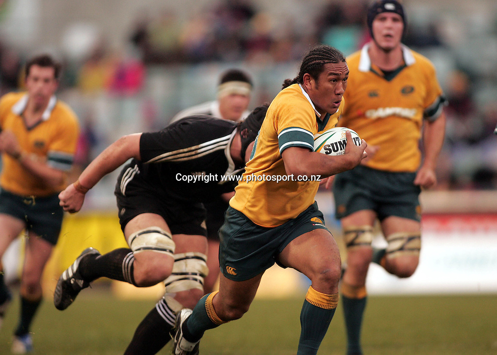 Australia's Junior Pelasasa breaks past Bernie Upton during the Match between the Australia A v Junior All Blacks at Canberra Stadium, Canberra on 26 June 2005. Junior All Blacks won the game 23-19. Photo: Paul Seiser &copy;Seiser Photography/PHOTOSPORT<br /> <br /> <br /> 128455