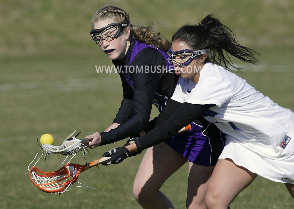 Monroe-Woodbury's Spencer Pavia, left, and Middletown's Gabrielle Flores battle for the ball during a game in Middletown on Monday, April 2, 2012.