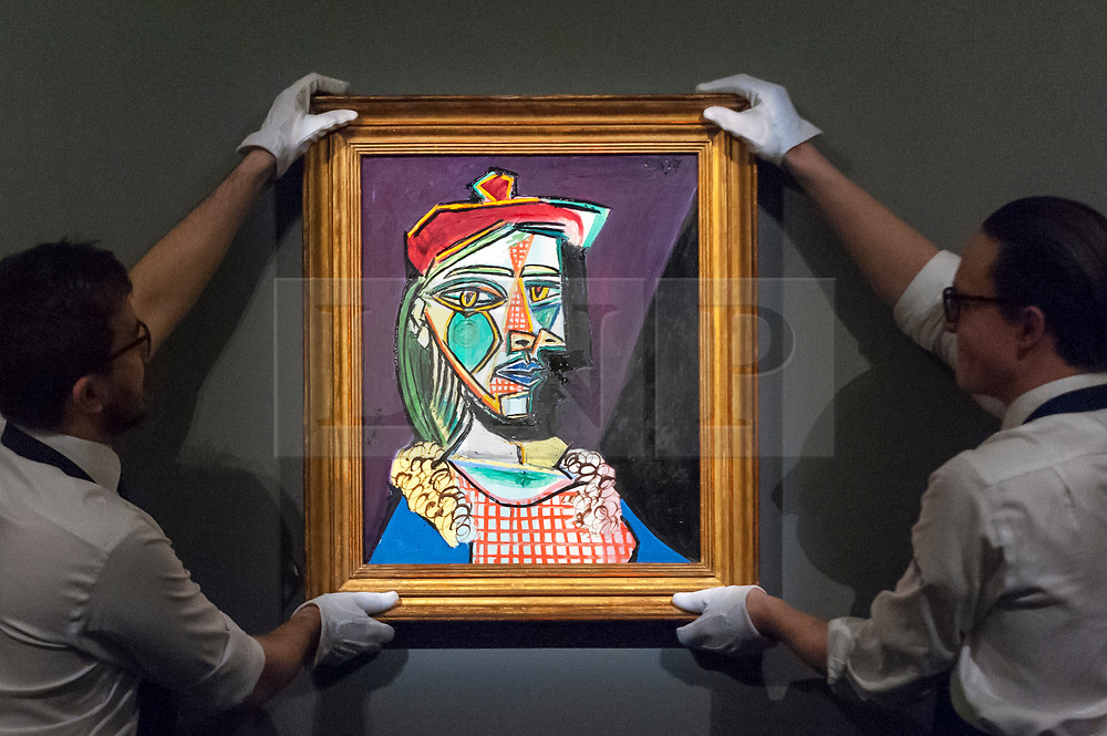 © Licensed to London News Pictures. 22/02/2018. LONDON, UK. Technicians present ''Femme Au Béret Et À La Robe Quadrillée (Marie-Thérèse Walter)'' by Pablo Picasso, (Est. in excess of $50,000,000) at the preview of Sotheby's upcoming Impressionist, Modern & Surrealist Art auctions taking place at Sotheby's, New Bond Street, on 28 February. Photo credit: Stephen Chung/LNP