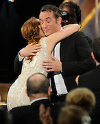 Berenice Bejo gives a hug to Jean Dujardin after he won Male Actor in a Leading Role.The 18th Annual Screen Actors Guild Awards were held at the Shrine Exposition Center in Los Angeles, CA 1/29/2012(John McCoy/Staff Photographer)