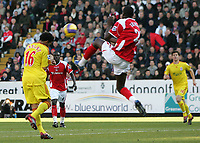 Photo: Lee Earle.<br /> Charlton Athletic v Liverpool. The Barclays Premiership. 16/12/2006. Charlton's Djimi Traore (R) goes in high on Jermaine Pennant to concede a penalty to Liverpool.