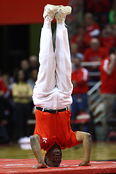 04 February 2012:  Illinois Secretary of State Jesse White performs a handstand while leading his troupe, the Jesse White Tumblers, at halftime during an NCAA Missouri Valley Conference mens basketball game where the Bradley Braves lost to the Illinois State Redbirds 78 - 48 in Redbird Arena, Normal IL