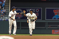 Aaron Hicks #32 of the Minnesota Twins is congratulated by Pedro Florimon #25 after he made a diving catch during a game against the Milwaukee Brewers on May 29, 2013 at Target Field in Minneapolis, Minnesota.  The Twins defeated the Brewers 4 to 1.  Photo: Ben Krause