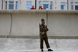 © Licensed to London News Pictures. 26/04/2016. Redcar, UK. As part of the build up to the 2018 Festival of Thrift 80 volunteers help artist and film-maker Richard DeDomenici make a 'Redux' version of the five minute Dunkirk scene from the 2007 Oscar winning film Atonement on Redcar beach. The Festival of Thrift, 19th – 25th August 2018, is a week-long programme of temporary art installations in locations across the Tees Valley landscape. Photo credit: Nigel Roddis/LNP