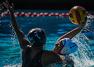 Cypress College's Joana Marquez  blocks the shot of Fullerton College's Gabi Perez  during their match during the Orange Empire Conference Women's Water Polo Championship, played at Saddleback College in Mission Viejo, California, Thursday, November 3, 2016.  Fullerton defeated Cypress College 17-3.<br /> Photo By: Bryan Woolston / Sports Shooter Academy