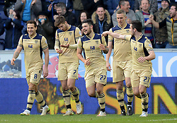 Leeds United's Alex Mowatt celebrates scoring the first goal with his team-mates - Photo mandatory by-line: Richard Martin-Roberts/JMP - Mobile: 07966 386802 - 07/03/2015 - SPORT - Football - Wigan - DW Stadium - Wigan Athletic v Leeds United - Sky Bet Championship