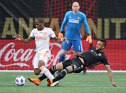 May 9, 2018 - Atlanta, GA, USA - Atlanta United midfielder Darlington Nagbe, left, battles Sporting Kansas City forward Khiry Shelton with goalkeeper Brad Guzan, top, looking on during the first half on Wednesday, May 9, 2018, in Atlanta. (Credit Image: © Curtis Compton/TNS via ZUMA Wire)